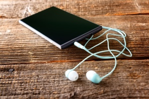 Small headphones with mobile phone
